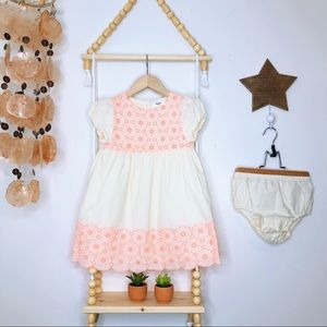 GIRLS MINI BODEN CREAM DRESS WITH NEON EMBROIDERY.